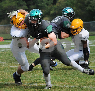 Glenbard West RB DJ Ficarella (1),  tries to break the tackle of Lyons Townships. Steve Bittinger for Shaw Media