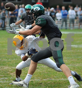 Glenbard West TE Alex Pihlstrom and a Lyons Township defender battle for possesion of a pass. Steve Bittinger for Shaw Media