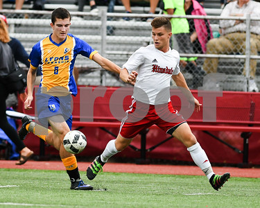 Lyons Township junior Tate Riordan (9) left and Hinsdale Central senior Jake Semba (21) battle for the ball in the first half of Friday's game. David Toney for Shaw Media
