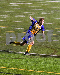Lyons Township junior Charles Clarke celebrates after scoring the winning goal in double over time and 5 new penalty kick players. David Toney for Shaw Media