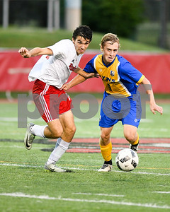Lyons Township senior Alec Gilcgrist battles for the ball against Hinsdale Central junior Ari Bourtsos (19) in the second half of Friday's match up. David Toney for Shaw Media