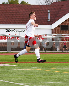 Hinsdale Central senior Jake Semba (21) celebrates the second goal during the second half of Friday's game agents Lyons Township. David Toney for Shaw Media