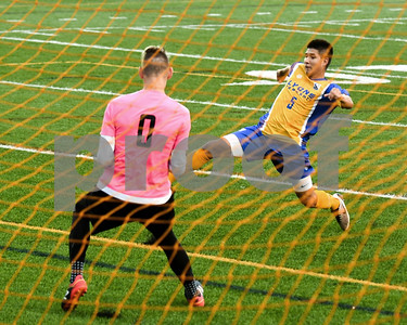 Lyons Township senior Isaiah Nieves puts the ball on goal that was blocked in the second half of Friday's game agents Hinsdale Central that a teammate put in right after. David Toney for Shaw Media