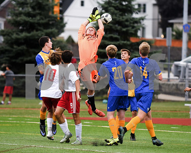 Lyons Township goal keeper Matt Vear (99) attempts to make a stop but slips through his hands but a teammate was able to kick the ball away in the first half of the game against Hinsdale Central. David Toney for Shaw Media