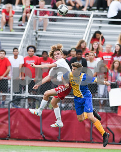 Lyons township ( 22) senior Dlyan Jones and Hinsdale Central senior Mike Usher (10) go up for a header in the first of Friday's match up. David Toney for Shaw Media