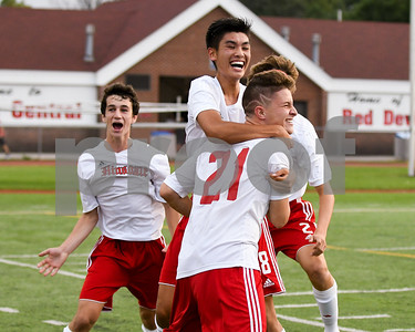 Hinsdale Central senior Jake Semba (21) celebrates with his teammates during the second goal during the second half of Friday's game against Lyons Township. David Toney for Shaw Media