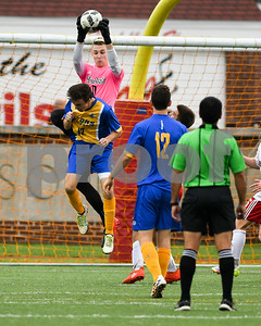 HInsdale Central Goal Keeper Connor Wilke (0) makes a save in the first half of Friday's match up as Lyons Township junior Quinn Fraser battles. David Toney for Shaw Media