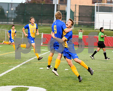 Lyons Township senior Dylan Jones (99) hugs Alec Gilchist (9) after tying up the game in the second half at 2 goals a piece. David Toney for Shaw Media