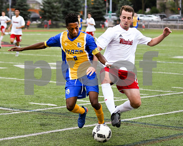 Lyons Township senior Devin Ekkstam (6) battles for the ball agents Hinsdale Central senior Will Naphin in the first half during Friday's match up. David Toney for Shaw Media