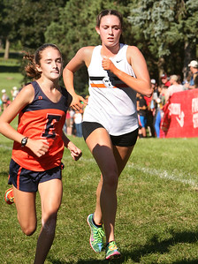 Wheaton Warrenville South's Emily Christensen crosses the finsh line Saturday, Sept. 3, 2016 just behind an Evanston runner at the Hornet-Red Devil Cross Country Invite. Sarah Minor for Shaw Media