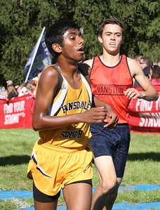 Hinsdale South's Chris Joseph crosses the finish line Saturday, Sept. 3, 2016 at the Hornet-Red Devil Invite. Sarah Minor for Shaw Media