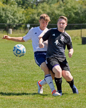 Lemont and Downers Grove North meet on the pitch during the Lemont Cup soccer tournament