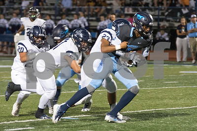 Downers Grove South's wide receiver, Damani White, pushes through Addison Trais defense to gain yards during the home game on Friday, September 16th. Lorae Mundt for Shaw Media