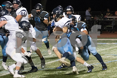 Downers Grove South's middle linebacker, Keiran Burke, #54, and  defensive tackle, Sergio Villalobos, #69, take down their opponent during the game against Addison Trail on Friday, September 16th. Lorae Mundt for Shaw Media