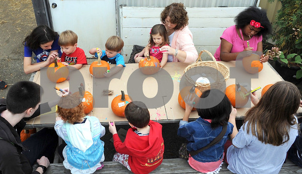 Children enjoy pumpkin decorating at Wannamaker's Home and Garden Fall Festival on Saturday, Septemer 24 in Downers Grove.  Steve Bittinger for Shaw Media