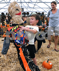 Tommy McMahon, 4, of Downers Grove, admires his scarecrow creation at Wannamaker's Home and Garden Fall Festival on Saturday, Septemer 24 in Downers Grove.  Steve Bittinger for Shaw Media