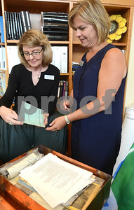Library Director Betsy Adamowski, (right) and Donna Freymark, librarian and genalogy specialist, look through a time capsule at the Wheaton Public Library Thursday, Sept. 1. The library is celebrating its 125th anniversary this year. There will be a presentation about the library's past, present and future at 7 p.m. Sept. 26. Mark Busch - mbusch@shawmedia.com
