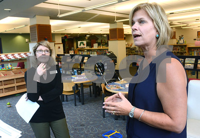 Library Director Betsy Adamowski (right) talks about some of the newer features of the childrens section of the Wheaton Public Library as Donna Freymark, librarian and genalogy specialist looks on Thursday, Sept. 1. The library is celebrating its 125th anniversary this year. There will be a presentation about the library's past, present and future at 7 p.m. Sept. 26. Mark Busch - mbusch@shawmedia.com