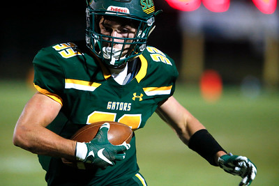 Kyle Leva (33) from Crystal Lake South carries the ball for his third touchdown of the game during the fourth quarter of their game against Crystal Lake Central at Crystal Lake South High School on Friday, September 1, 2017 in Crystal Lake, Illinois. John Konstantaras photo for Shaw Media