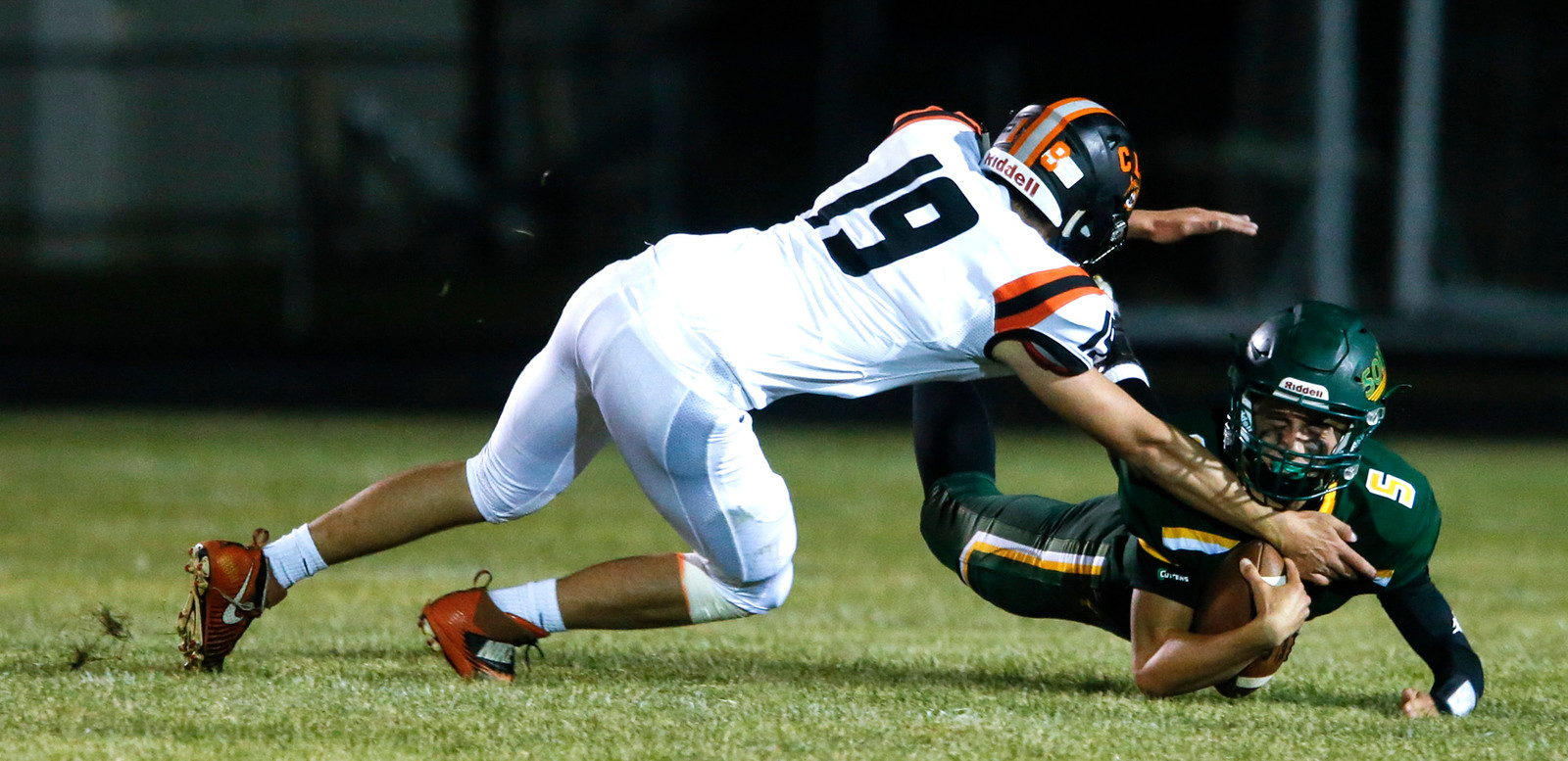 Quarterback Ian Gorken (5) from Crystal Lake South is sacked by Thomas Keene (19) from Crystal Lake Central during the second quarter of their game at Crystal Lake South High School on Friday, September 1, 2017 in Crystal Lake, Illinois. John Konstantaras photo for Shaw Media