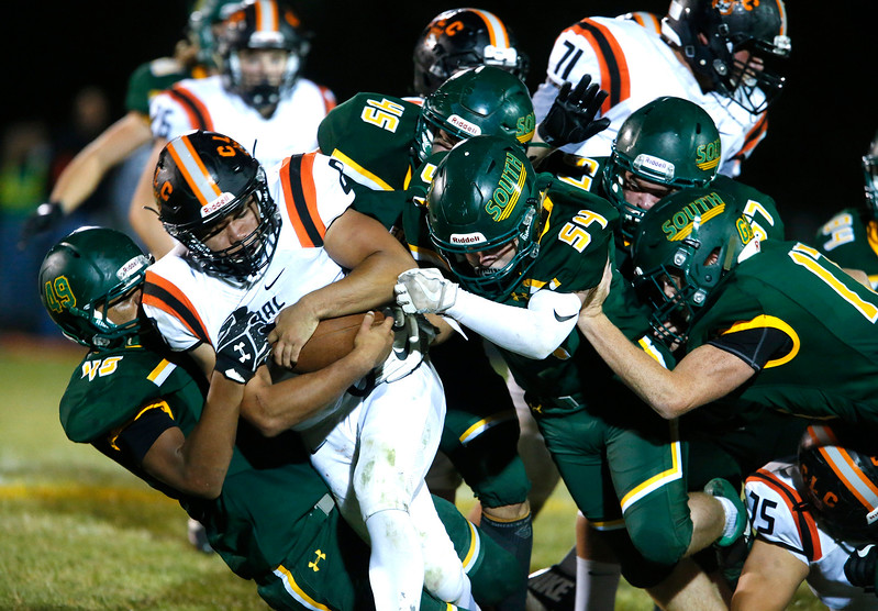 Braden Bisram (8) from Crystal Lake Central is stopped by a pack of Crystal Lake South defenders during the fourth quarter of their game at Crystal Lake South High School on Friday, September 1, 2017 in Crystal Lake, Illinois. John Konstantaras photo for Shaw Media