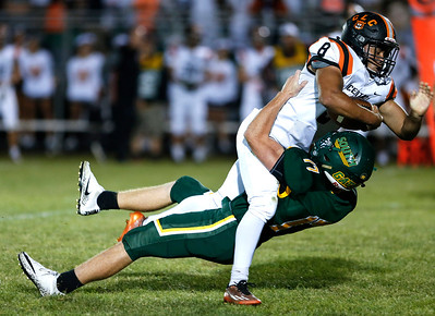 Braden Bisram (8) from Crystal Lake Central runs over Billy Epperson (17) from Crystal Lake South for a first down during the second quarter of their game at Crystal Lake South High School on Friday, September 1, 2017 in Crystal Lake, Illinois. John Konstantaras photo for Shaw Media