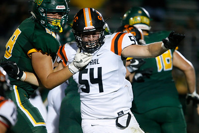 Cade Keenan (54) from Crystal Lake Central works to get around Trevor Keegan (58) from Crystal Lake South during their game at Crystal Lake South High School on Friday, September 1, 2017 in Crystal Lake, Illinois. John Konstantaras photo for Shaw Media