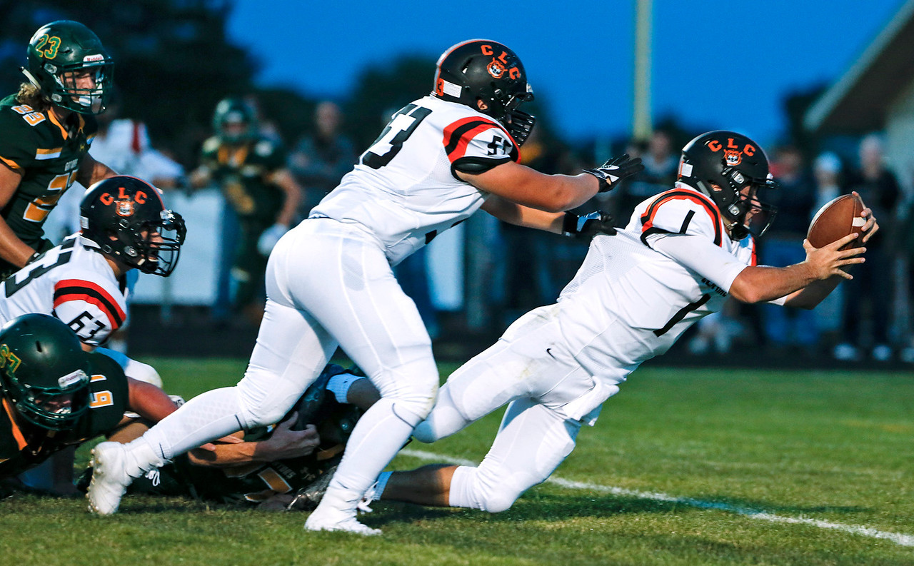 Quarterback Jacob Staples (1) from Crystal Lake Central dives into the end zone for a touchdown during the first quarter of their game against Crystal Lake South on Friday, September 1, 2017 in Crystal Lake, Illinois. John Konstantaras photo for Shaw Media