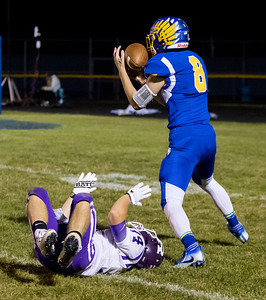 Johnsburg's Augie Rowe takes away a would-be interception and goes on into the end zone for a Johnsburg touchdown Friday, September 1, 2017 at Johnsburg High School in Johnsburg. Johnsburg went on to a 40-22 win over a tough Rochelle team. KKoontz – for Shaw Media