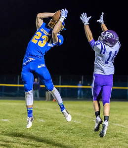 Johnsburg's Brody Frazier goes up high to make the catch Friday, September 1, 2017 at Johnsburg High School in Johnsburg. Johnsburg went on to a 40-22 win over a tough Rochelle team. KKoontz – for Shaw Media