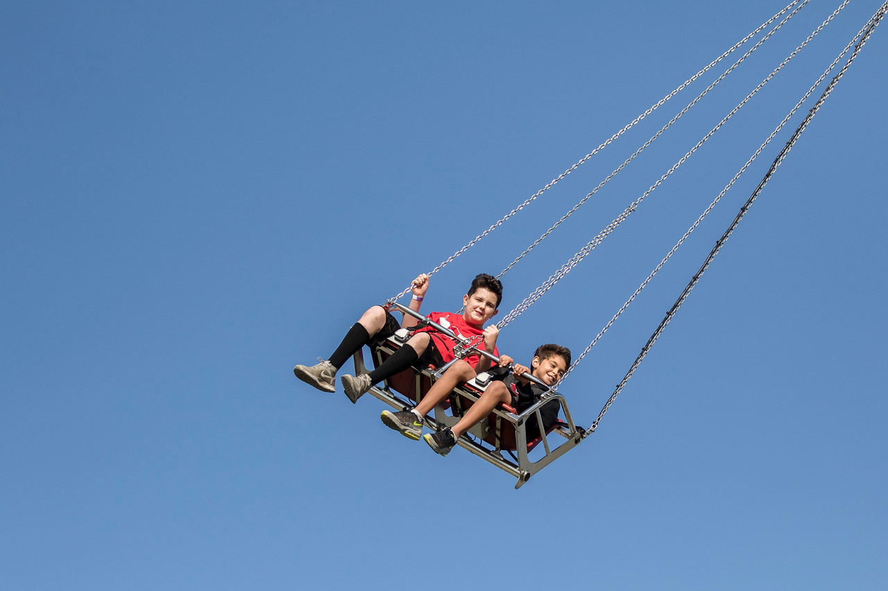 Sarah Nader - snader@shawmedia.com Gavin Craig (left), 11 of Algonquin and Logan Parks, 10, of Lake in the Hills ride on the swings while attending the 16th annual Lake in the Hills Summer Sunset Festival Friday, Sept. 1, 2017. The event continues through Sunday and features a parade, carnival rides, a craft show, Battle of the Bands, car show, fireworks and more.