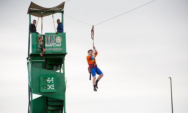 Mike Greene - For Shaw Media  Jack Rice, 11 of Algonquin, rides down a zip line during the 2nd annual Harvard Balloon Festival Saturday, September 2, 2017 at Milky Way Park in Harvard. This year's event features hot air balloon rides, food vendors, helicopter rides, inflatables, live entertainment, games and more.