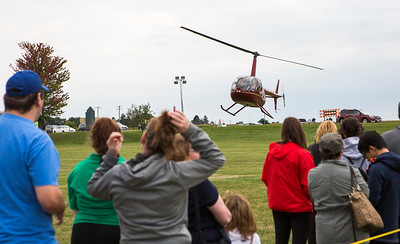Mike Greene - For Shaw Media  A crowd watches as a helicopter lands during the 2nd annual Harvard Balloon Festival Saturday, September 2, 2017 at Milky Way Park in Harvard. This year's event features hot air balloon rides, food vendors, helicopter rides, inflatables, live entertainment, games and more.
