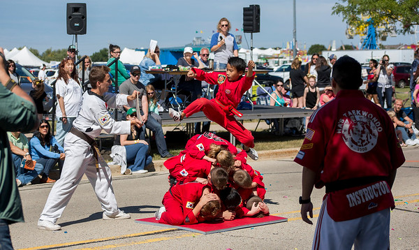 Mike Greene - For Shaw Media  Members of Ha's Taekwondo Academy perform during the parade as part of the 16th annual Summer Sunset Festival Saturday, September 2, 2017 at Sunset Park in Lake in the Hills. This year's event featured a parade, carnival rides, a craft show, Battle of the Bands, a classic and custom car show, horsehoe and bags tournaments, the Sunset 5K and fireworks.