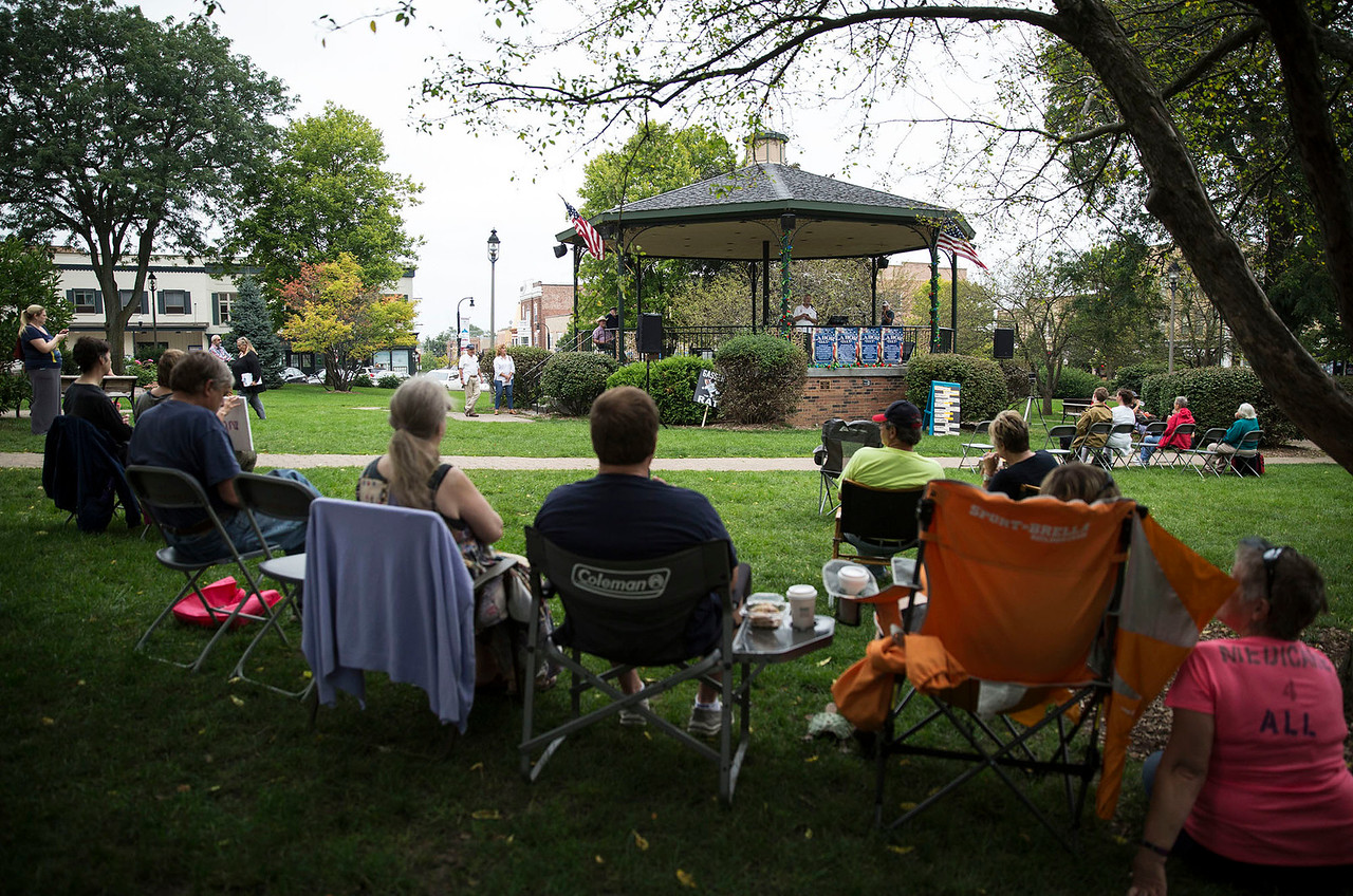 Families listen as Brian Dupols, with Northeastern Illinois Federation of Labor, AFL/CIO, speaks during a Labor Day Celebration in Woodstock Square on Monday, September 4, 2017 in Woodstock, Illinois. The event is held by the McHenry County Progressives in Support of Working Families. John Konstantaras photo for Shaw Media