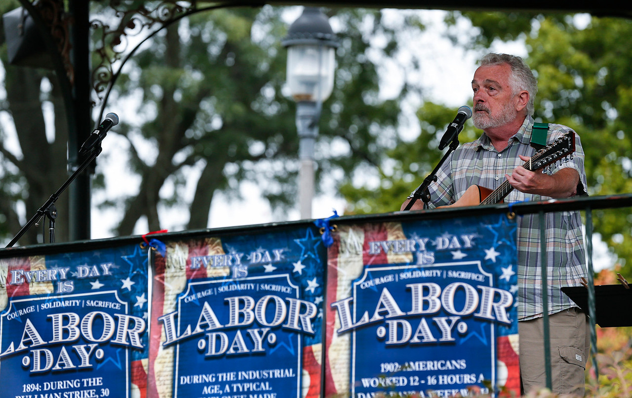 Don Humbertson, with Off Square Music, performs during a Labor Day Celebration in Woodstock Square on Monday, September 4, 2017 in Woodstock, Illinois. The event is held by the McHenry County Progressives in Support of Working Families. John Konstantaras photo for Shaw Media