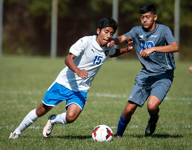 Ivan Juanchi (15) from Dundee-Crown works to get around Miguel Moreno (19) from Larkin during the first half of their game on Saturday, September 9, 2017 in Carpentersville, Illinois. John Konstantaras photo for Shaw Media