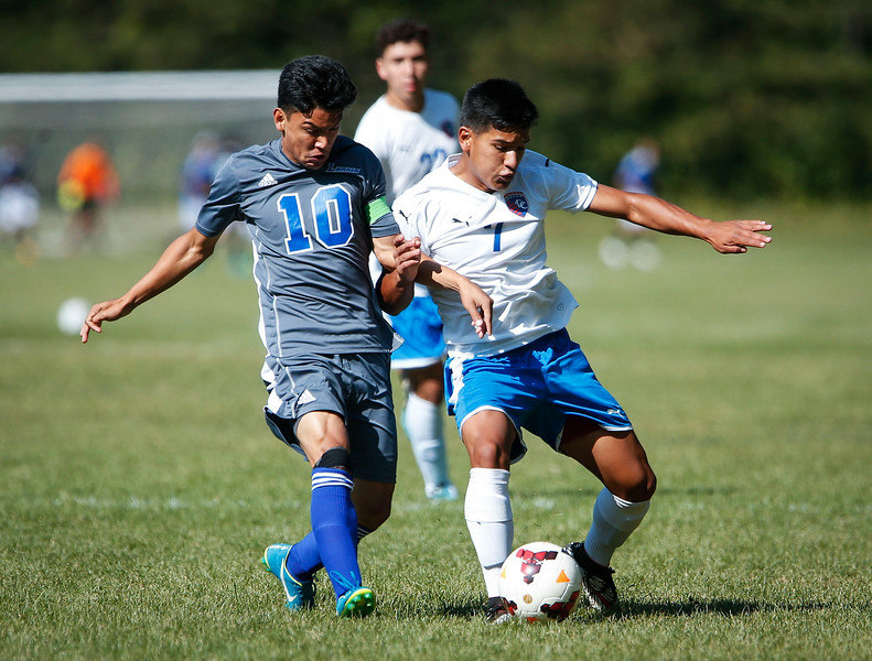 Gerardo Estrada (7) from Dundee-Crown and Sammy Rodriguez (10) from Larkin battle for a ball during the first half of their game on Saturday, September 9, 2017 in Carpentersville, Illinois. John Konstantaras photo for Shaw Media