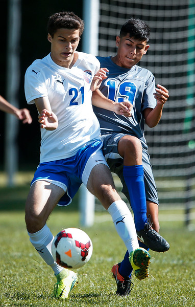 Jason Miller (21) from Dundee-Crown and Miguel Moreno (19) from Larkin work for a ball during the first half of their game on Saturday, September 9, 2017 in Carpentersville, Illinois. John Konstantaras photo for the Shaw Media