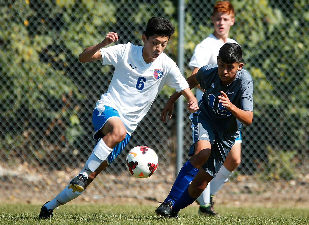 Arnol Batres (6) from Dundee-Crown takes the ball past Miguel Moreno (19) from Larkin during the first half of their game on Saturday, September 9, 2017 in Carpentersville, Illinois. John Konstantaras photo for Shaw Media