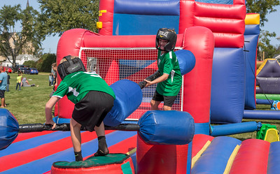Mike Greene - For Shaw Media  Alex Falco, 6, right of Johnsburg, jousts with Cayden Moran, 7 of Johnsburg, during the 45th annual Saufen und Spiel Parade festivities Sunday, September 10, 2017 in Johnsburg. This year's event featured a variety of food vendors, inflatables, live music, as well as the annual Cow Drop raffle.