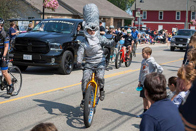 Mike Greene - For Shaw Media  A member of The Bike Haven's group waves to the crowd while wearing a squirrel outfit during the 45th annual Saufen und Spiel Parade Sunday, September 10, 2017 in Johnsburg. This year's event featured a variety of food vendors, inflatables, live music, as well as the annual Cow Drop raffle.