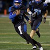 St. Francis's Sidney Moore carries the ball against Marmion Academy on Sept 8 in Wheaton. Marmion won the game 42-14.