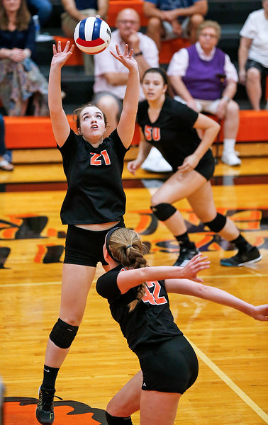 Olivia Doak (21) from Crystal Lake Central sets the ball during their first game against Prairie Ridge at Crystal Lake Central High School on Thursday, 9/14/17 in Crystal Lake, Illinois. The Tigers won the match in 2 games; 25-22, 25-17. John Konstantaras photo for Shaw Media