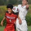 Yorkville junior Alex Barrientos and Kaneland sophomore Tucker Jahns go up for a header during their game Sept. 12 at Kaneland High School.<br /> Mark Busch - mbusch@shawmedia.com