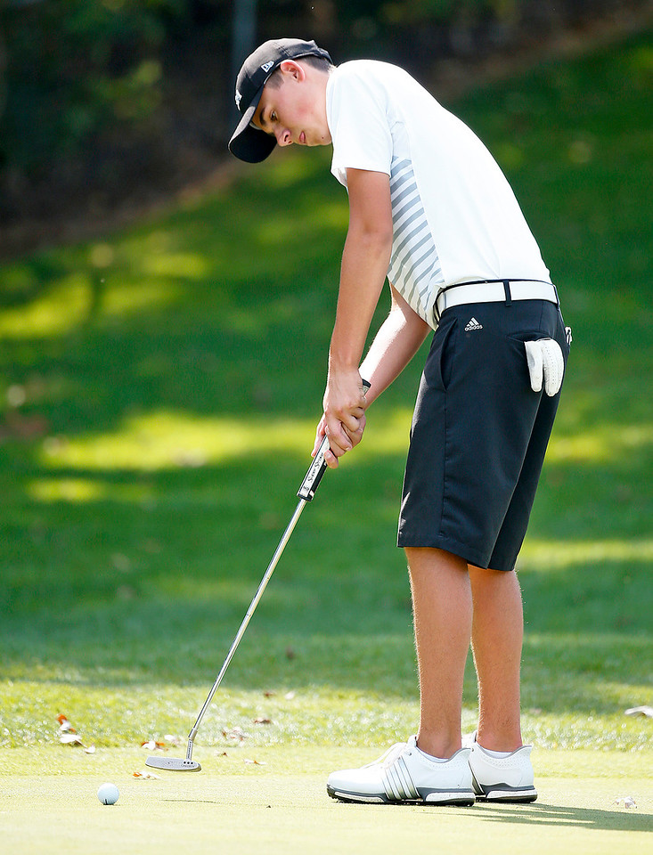 Jacobs' Garrett Tighe putts on the 4th green during the Dundee-Crown Charger Boys Golf Invitational at Randall Oaks Golf Club on Saturday, 9/16/17 in West Dundee, Illinois. John Konstantaras photo for Shaw Media