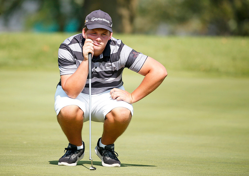 Prairie Ridge's Cameron Karney sizes up a putt during the Dundee-Crown Charger Boys Golf Invitational at Randall Oaks Golf Club on Saturday, 9/16/17 in West Dundee, Illinois. John Konstantaras photo for Shaw Media