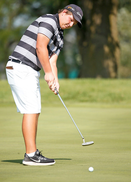 Prairie Ridge's Cameron Karney putts during the Dundee-Crown Charger Boys Golf Invitational at Randall Oaks Golf Club on Saturday, 9/16/17 in West Dundee, Illinois. John Konstantaras photo for Shaw Media