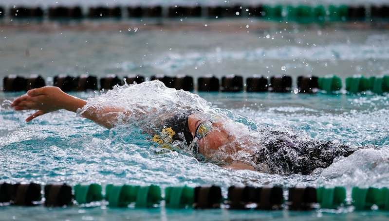 Atzi Gomez, from Jacobs, swims the backstroke in the 200 yard IM during the Woodstock Swimming Invite at Woodstock North High School on Saturday, 9/16/17 in Woodstock, Illinois. John Konstantaras photo for Shaw Media