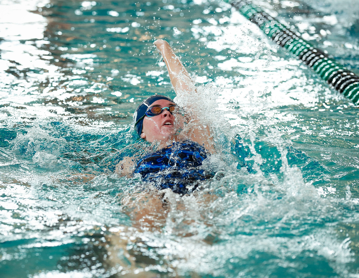 Emma Boldwyn, from Cary-Grove, swims the backstroke during the  200 yard medley relay during the Woodstock Swimming Invite at Woodstock North High School on Saturday, 9/16/17 in Woodstock, Illinois. John Konstantaras photo for Shaw Media